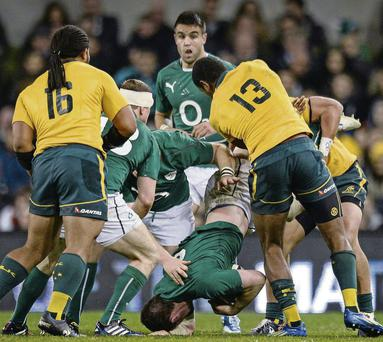 Peter O'Mahony, Ireland, is tackled by Tevita Kuridrani (No. 13), of Australia.