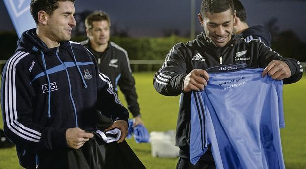 All Black and Blue: Dublin football star Bernard Brogan and New Zealand's Charlie Piutau exchange jerseys during yesterday's skills challenge in Westmanstown, Dublin, which was organised by AIG which sponsors both teams BRENDAN MORAN/SPORTSFILE