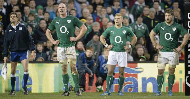 Paul O'Connell, Ian Madigan and Sean O'Brien watch New Zealand's injury-time conversion go over the posts