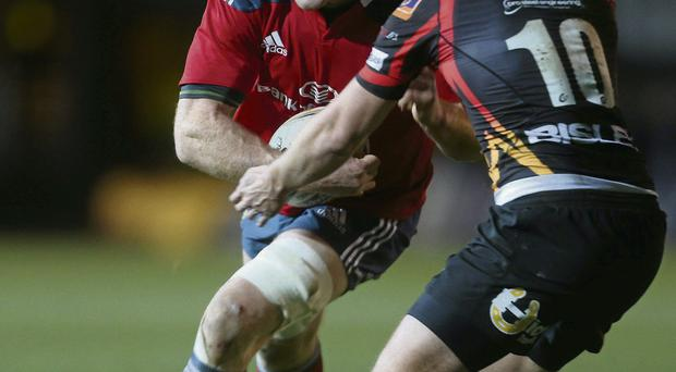 Munster's Paul O'Connell is tackled by Jason Tovey of Newport Gwent Dragons in the game at Rodney Parade STEVE POPE / SPORTSFILE