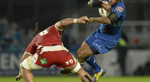 Leinster's Lote Tuqiri is sent flying by Sione Timani, a tackle for which the Scarlets player was shown a yellow card, during their clash at The RDS last night.