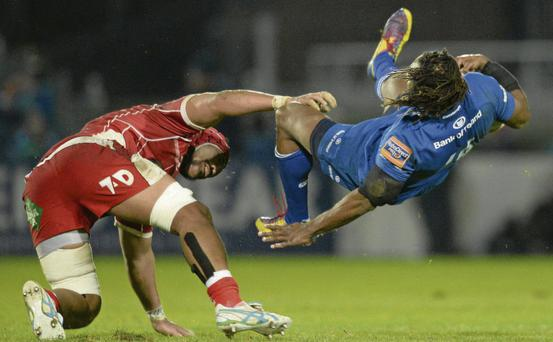 Sione Timani tackles Leinster's Lote Tuquiri in the incident which led to the Scarlets player being shown the yellow card at the RDS.