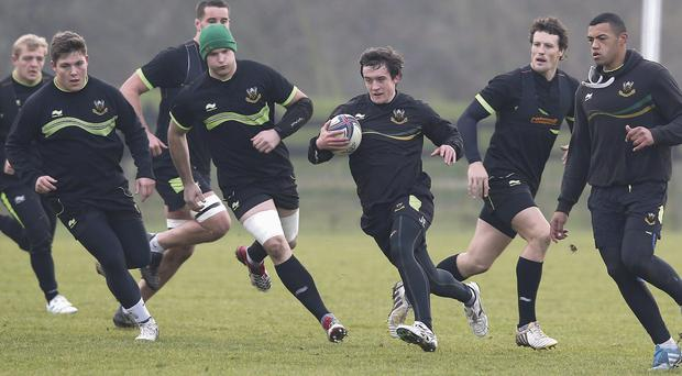 Jamie Elliott runs with the ball during Northampton's training session held at Franklin Gardens yesterday ahead of Saturday's game against Leinster