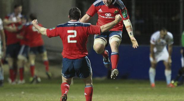 James Coughlan leaps into the air to celebrate with team-mate Damien Varley