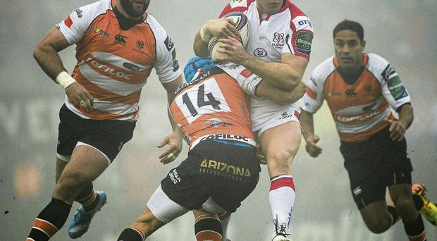 Ulster's Craig Gilroy is tackled by Ludovico Nitoglia of Treviso during their Heineken Cup Pool 5 game