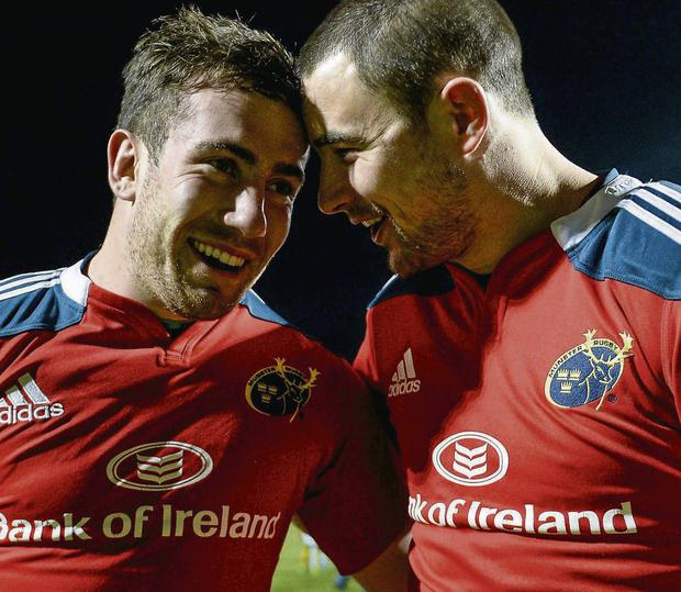 Munster's JJ Hanrahan (L) celebrates with Felix Jones after his last-gasp try secured victory over Perpignan sportsfile