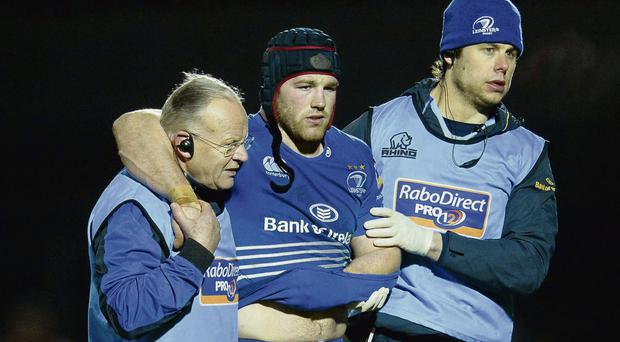 Leinster's Sean O'Brien is helped from the pitch