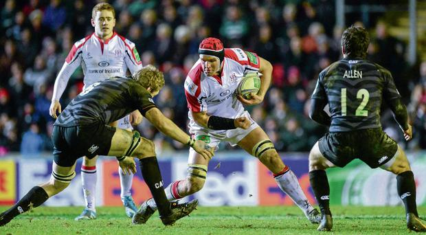 Ulster's Dan Tuohy braces himself for the challenge of Jamie Gibson at Welford Road yesterday. Photo: Oliver McVeigh