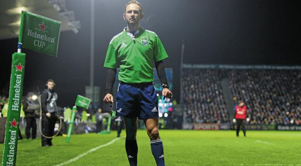 Referee Romain Poite watches a replay on the big screen at the RDS