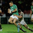 Simon Zebo of the Ireland Wolfhounds is tackled by Calum Clark (England Saxons) during their clash in Kingsholm Rogan Thomson/SPORTSFILE