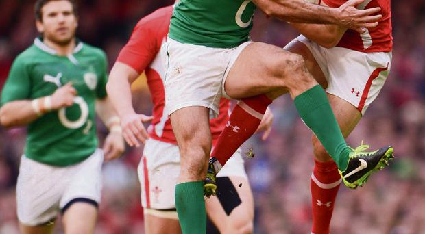 Dragon slayer: Rob Kearney tackles Leigh Halfpenny during Ireland's victory over Wales at the Millennium Stadium last year. STEPHEN McCARTHY/SPORTSFILE