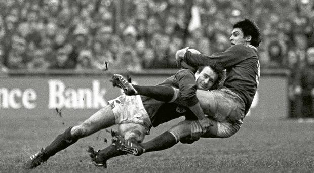 Picture 1. Who is the Ireland player tackling Mark Douglas of Wales in this 1984 Five Nations match at Lansdowne Road?