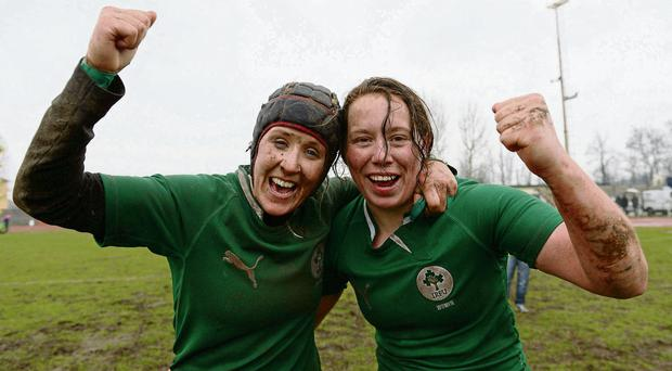 Joy unconfined: Ireland's Joy Neville and Niamh Kavanagh celebrate after the final whistle of last year's victory over Italy in Milan, which sealed the side's Six Nations Championship win in Milan on St Patrick's Day.