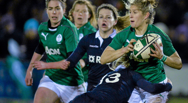 Alison Miller, Ireland, is tackled by Annabel Sergeant, Scotland.