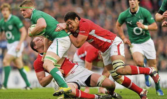 Toby Faletau tackles Jamie Heaslip during Ireland's clash against Wales in 2012 Stephen McCarthy