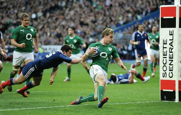 Andrew Trimble dives in to score Ireland's second try during the Six Nations match at the Stade de France in March