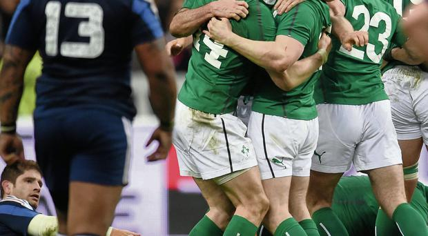 Irish players celebrate victory in Paris last year that sealed the 2014 Six Nations championship.