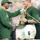 Francois Piennar receiving the 1995 Rugby World Cup trophy from then South African President Nelson Mandela. David Rogers