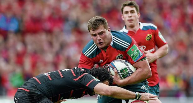 CJ Stander is tackled by Yoann Huget during yesterday's Heineken Cup quarter-final between Munster and Toulouse at Thomond Park. Photo: Diarmuid Greene