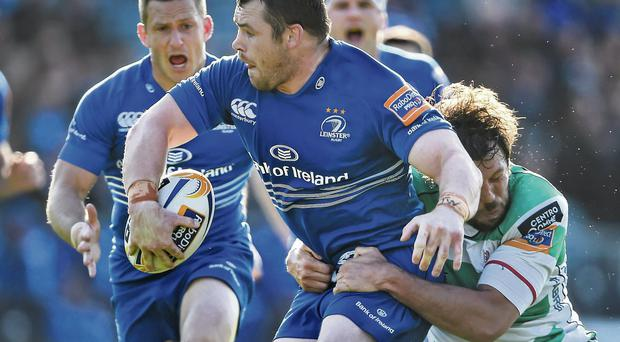 Cian Healy passes the ball to Leinster team-mate Jimmy Gopperth as he is tackled by Treviso's Valerio Bernabò at the RDS yesterday
