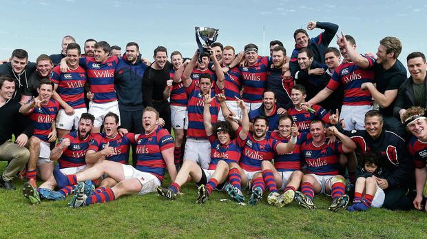 Clontarf players celebrate with the Ulster Bank League Division 1A trophy after victory over Ballynahinch, Castle Avenue, Clontarf Ramsey Cardy / SPORTSFILE
