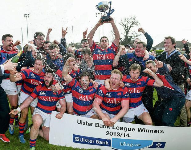 Clontarf players celebrate with the Division 1A trophy last month