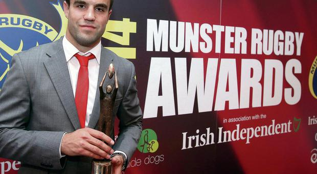 Conor Murray with his Munster player of the year award at the Maryborough Hotel in Cork yesterday