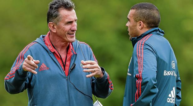 Rob Penney speaks with Simon Zebo during training