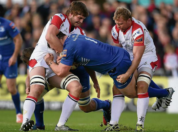 Leinster's Cian Healy is tackled by Ulster duo Iain Henderson and Roger Wilson earlier this month