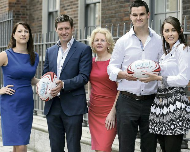 Ronan O'Gara and Johnny Sexton at the official opening of Laya Healthcare's new Dublin office with Laya Healthcare team members Caitriona Coffey, Mary Forde and Marie Kelly
