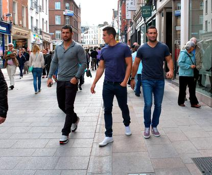 Irish rugby playing brothers Rob Kearney and Dave Kearney seen walking down Grafton Street with fellow player Noel Reid (centre). Picture: Cathal Burke / VIPIRELAND.COM