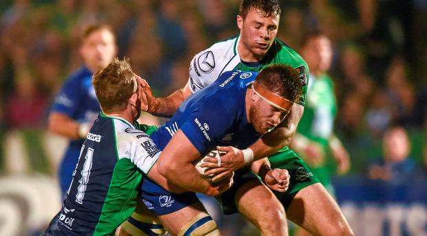 Dominic Ryan, Leinster, is tackled by Matt Healy, left, and Robbie Henshaw, Connacht.