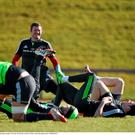 Munster players – including Donnacha Ryan – take a break during training in Limerick