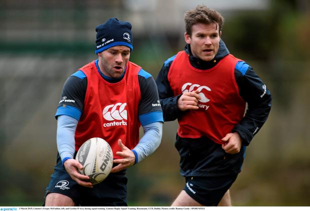 Fergus McFadden in action alongside Gordon D'Arcy during training at UCD this week. Photo: Ramsey Cardy / SPORTSFILE