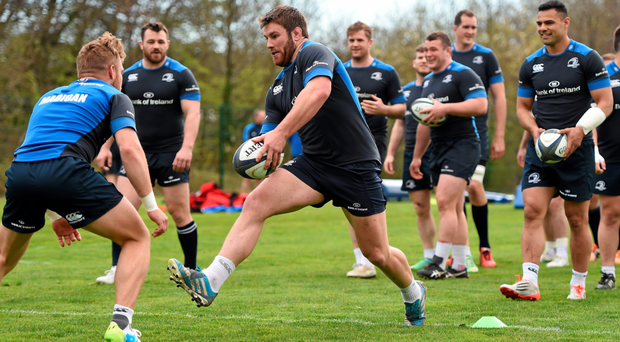 Sean O'Brien takes on Ian Madigan during a Leinster training drill ahead of Sunday's Champions Cup Clash with Toulon