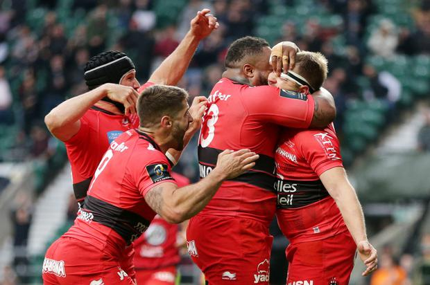 Mathieu Bastareaud congratulates Drew Mitchell for scoring the try that effectively won the Champions Cup for Toulon