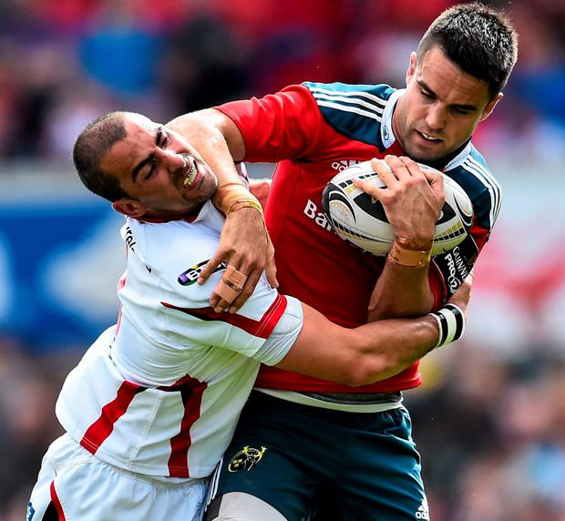 Conor Murray is tackled by Ruan Pienaar