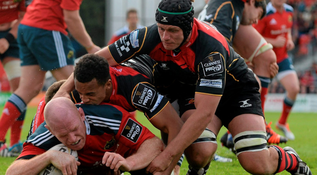 Paul O'Connell burrows his way over for Munster's fifth try against Dragons. Photo: Diarmuid Greene