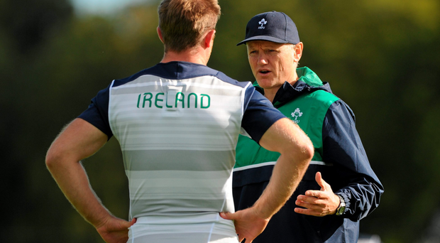 Joe Schmidt speaking with Luke Fitzgerald during yesterday's training session in Carton House as the Ireland head coach finalises his plans for the opening World Cup game on Saturday