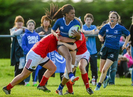 Eimear Corry, Leinster, is tackled by Enya Breen, left, and, Erica O'Connor during the U-18 Girls Development Interprovincial at Westmanstown
