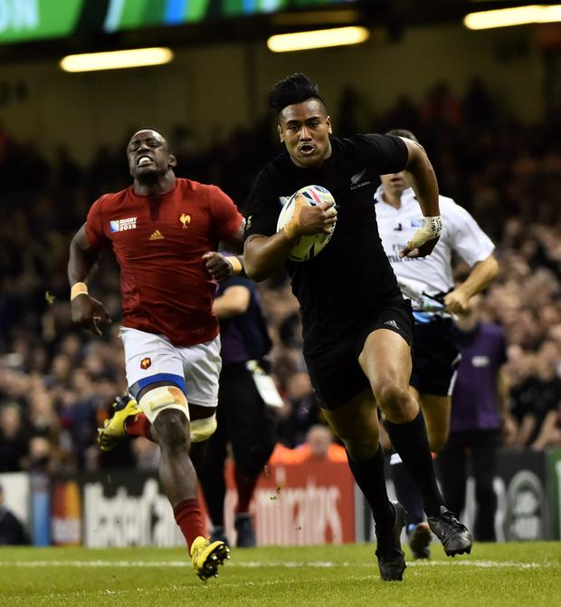 Julian Savea scores one of his tries against France
