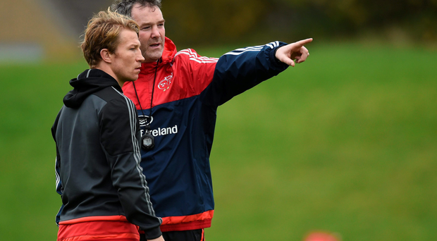 Anthony Foley speaks with Jerry Flannery during training ahead of their game against Treviso