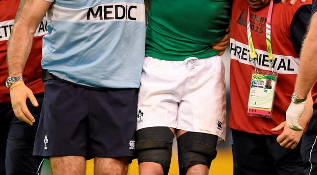 Paul O'Connell leaves the pitch injured in his final appearance in a green jersey at half-time in the World Cup Pool D clash with France.