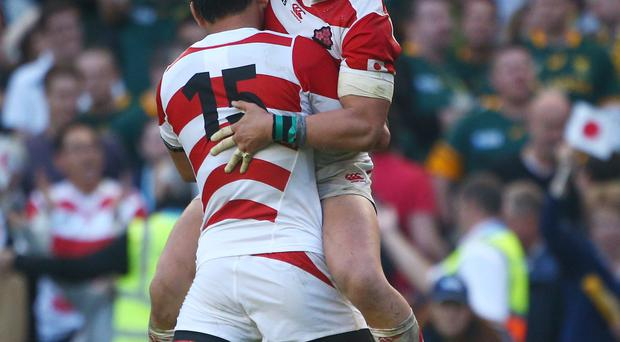 Harumichi Tatekawa and Ayumu Goromaru of Japan celebrate their historic World Cup victory over South Africa. Picture: Getty Images.