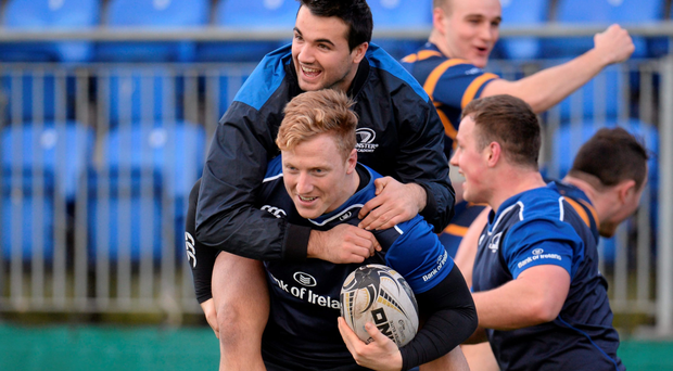 Leinster's James Tracy carries team-mate Cian Kelleher during training in Donnybrook (Photo: Sportsfile)