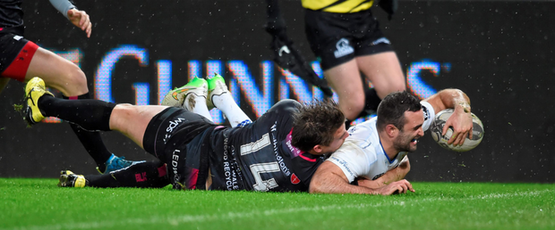 Dave Kearney beats Jeff Hassler to score Leinster's first try against the Ospreys last weekend. Photo: Sportsfile