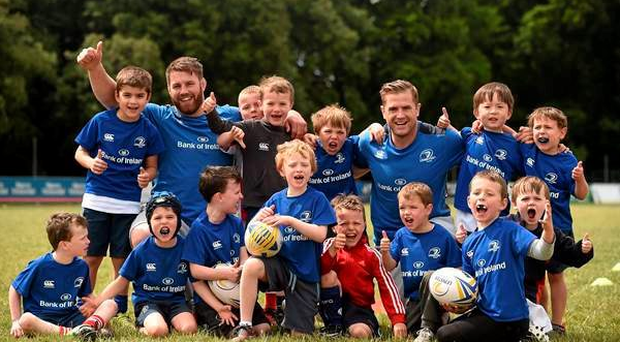 Sean O'Brien and Jamie Heaslip with youngsters on a Leinster Rugby summer camp Photo: Sportsfile