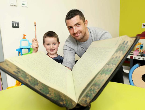 CMRF Crumlin ambassador Rob Kearney joined Jamie Burke (5) from Cork to launch Crumlin's Big Book of Memories in honour of the 60th anniversary of Our Lady's Children's Hospital Crumlin (SPORTSFILE)
