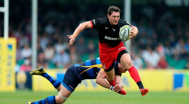 Saracens' Alex Goode is tackled by Worcester Warriors' Sam Betty during the Aviva Premiership match at Sixways Stadium. Photo: PA