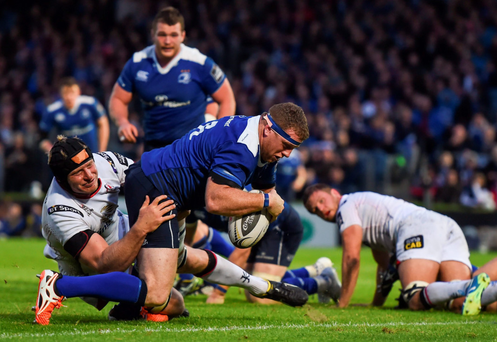 Sean Cronin goes over to score Leinster's third try against Ulster at the RDS on Friday night. Photo: Stephen McCarthy